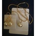 Parure en métal plaqué or rose et perle