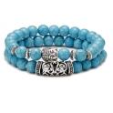 2 bracelets en pierres turquoises avec tête de bouddha et symbole argentés